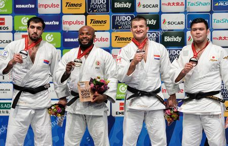 Stock Photo of Gold medalist Jorge Fonseca (2-L) of Portugal celebrates with silver medalist Niyaz Ilyasov (L) of Russia, bronze medalists Michael Korrel (2-R) of the Netherlands and Aaron Wolf of Japan on podium after the men's -100kg category final at the Judo World Championships 2019 in Tokyo, Japan, 30 August 2019.