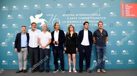 Italian producers Paolo Del Brocco and Luca Barbareschi, French producer Alain Goldman, French composer Alexandre Desplat and French actors Emmanuelle Seigner, Louis Garrel and Jean Dujardin pose at a photocall for 'J'Accuse' (An Officer and a Spy) during the 76th annual Venice International Film Festival, in Venice, Italy, 30 August 2019. The movie is presented in the official competition 'Venezia 76' at the festival running from 28 August to 07 September.