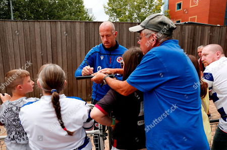 Charlie Adam of Reading signs autographs