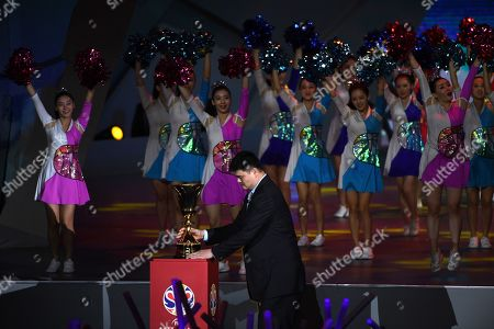 Stock Picture of Former NBA player from China, Yao Ming, holds the trophy during the opening ceremony of the FIBA 2019 Basketball World Cup in Beijing on August 30, 2019.