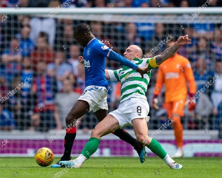 Glen Kamara of Rangers tackled by Celtic captain Scott Brown