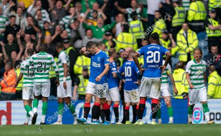Jordan Jones of Rangers is sent off by Referee Bobby Madden for a late challenge on Moritz Bauer of Celtic