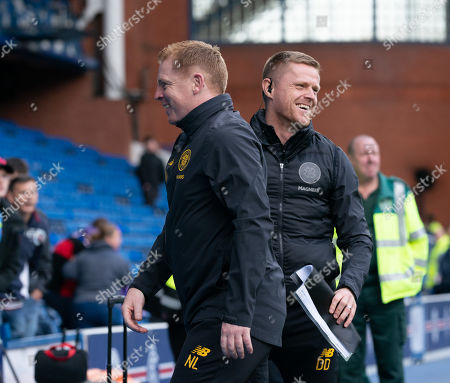 Celtic Manager Neil Lennon smiles with Celtic first team coach Damien Duff as they celebrate their 2-0 win at Ibrox.