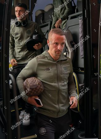 Leigh Griffiths of Celtic steps off the Celtic team bus at Ibrox Stadium