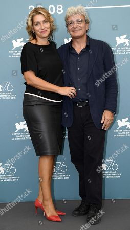 Mario Martone (R) and Italian screenwriter Ippolita di Majo pose at a photocall for 'Il Sindaco del rione Sanita' during the 76th annual Venice International Film Festival, in Venice, Italy, 30 August 2019. The movie is presented in the official competition 'Venezia 76' at the festival running from 28 August to 07 September.