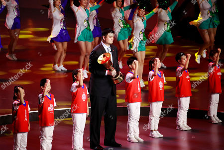 Former Chinese NBA player Yao Ming holds the FIBA World Cup trophy during the FIBA Basketball World Cup 2019 opening ceremony at the Beijing National Aquatics Center or Water Cube in Beijing, China, 30 August 2019.