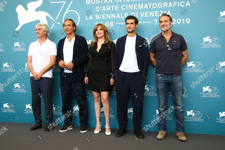 Alain Goldman, Alexandre Desplat, Louis Garrel, Emmanuelle Seigner, Jean Dujardin. Producer Alain Goldman, from left, composer Alexandre Desplat, actors Louis Garrel, Emmanuelle Seigner and Jean Dujardin poses for photographers at the photo call for the film 'An Officer and a Spy' at the 76th edition of the Venice Film Festival in Venice, Italy