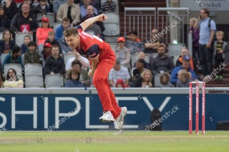 Stock Image of James Faulkner bowling during the Vitality T20 Blast North Group match between Lancashire Lightning and Leicestershire Foxes at the Emirates, Old Trafford, Manchester