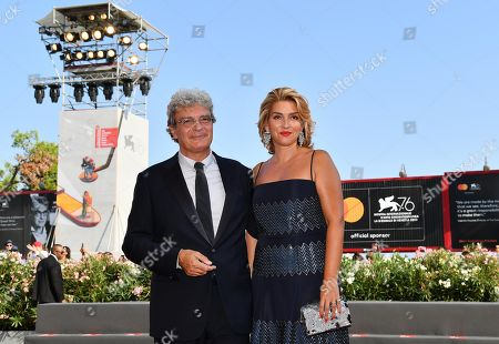 Mario Martone (L) and Italian screenwriter Ippolita di Majo arrive for the premiere of 'Il Sindaco del Rione Sanita' during the 76th annual Venice International Film Festival, in Venice, Italy, 30 August 2019. The movie is presented in the official competition 'Venezia 76' at the festival running from 28 August to 07 September.
