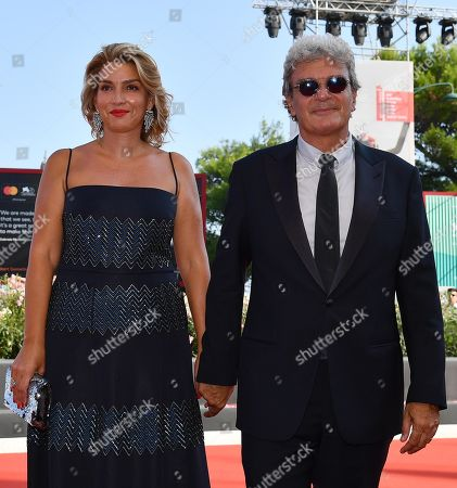 Mario Martone (R) and Italian screenwriter Ippolita di Majo arrive for the premiere of 'Il Sindaco del Rione Sanita' during the 76th annual Venice International Film Festival, in Venice, Italy, 30 August 2019. The movie is presented in the official competition 'Venezia 76' at the festival running from 28 August to 07 September.