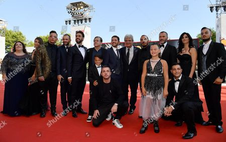 Mario Martone (7-R) with members of the cast arrives for the premiere of 'Il Sindaco del Rione Sanita' during the 76th annual Venice International Film Festival, in Venice, Italy, 30 August 2019. The movie is presented in the official competition 'Venezia 76' at the festival running from 28 August to 07 September.