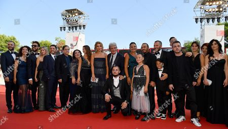 Mario Martone (C) with members of the cast arrives for the premiere of 'Il Sindaco del Rione Sanita' during the 76th annual Venice International Film Festival, in Venice, Italy, 30 August 2019. The movie is presented in the official competition 'Venezia 76' at the festival running from 28 August to 07 September.