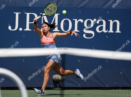 Anastasija Sevastova, of Latvia, returns a shot to Petra Martic, of Croatia, during round three of the US Open tennis championships, in New York