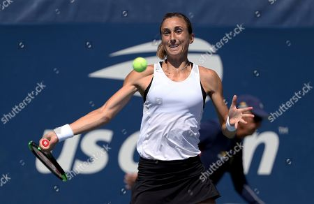 Petra Martic, of Croatia, returns a shot to Anastasija Sevastova, of Latvia, during round three of the US Open tennis championships, in New York