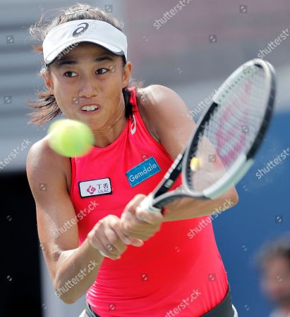 Zhang Shuai, of China, returns a shot to Johanna Konta, of the United Kingdom, during round three of the US Open tennis championships, in New York