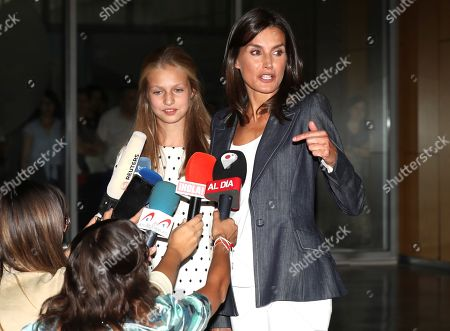 Spain's Queen Letizia (R) and her daughter, Princess Leonor (L), talk to members of the media as they leave the Hospital Quiron Salud Madrid following their visit to emeritus King Juan Carlos I (unseen), in the town of Pozuelo de Alarcon, outside Madrid, Spain, 30 August 2019. The monarch recovers in the hospital from a triple bypass surgery on 24 August.