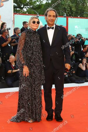 Alexandre Desplat, Dominique Lemonnier. Composer Alexandre Desplat, right, and his wife Dominique Lemonnier pose for photographers upon arrival at the premiere of the film 'An Officer and a Spy' at the 76th edition of the Venice Film Festival, Venice, Italy