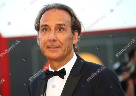 Alexandre Desplat poses for photographers upon arrival at the premiere of the film 'An Officer and a Spy' at the 76th edition of the Venice Film Festival, Venice, Italy