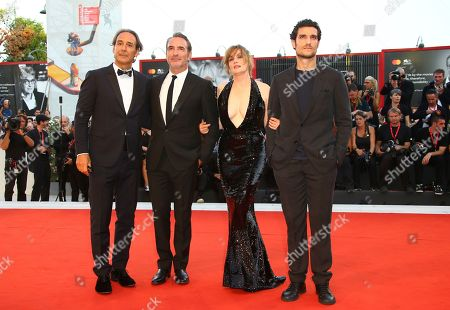 Louis Garrel, Emmanuelle Seigner, Jean Dujardin, Alexandre Desplat. Actors Louis Garrel, from right, Emmanuelle Seigner, Jean Dujardin and Alexandre Desplat pose for photographers upon arrival at the premiere of the film 'An Officer and a Spy' at the 76th edition of the Venice Film Festival, Venice, Italy