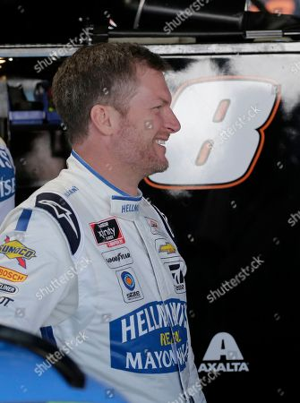 Dale Earnhardt Jr. smiles in the garage before practice for a NASCAR auto race, in Darlington, S.C.. Earnhardt is scheduled to run in the Xfinity race on Saturday