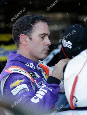 Jimmie Johnson prepares to leave the garage after practice for a NASCAR auto race, in Darlington, S.C