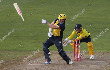 Stock Photo of Shaun Marsh of Glamorgan throws his bat whist he tries to hit a shot.