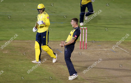Roman Walker of Glamorgan celebrates after Aneurin Donald is caught by Shaun Marsh.