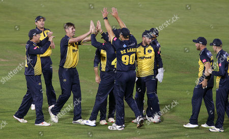 Roman Walker of Glamorgan celebrates with team mates after Aneurin Donald is caught by Shaun Marsh.