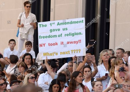Stock Picture of People wait in line to hear Attorneys Michael H. Sussman and Robert F. Kennedy, Jr. speak at a hearing challenging the constitutionality of the state legislature's repeal of the religious exemption to vaccination on behalf of New York state families who held lawful religious exemptions, during a rally outside the Albany County Courthouse, in Albany, N.Y