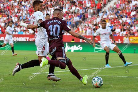 Stock Image of Sevilla FC's Daniel Carrico (L) in action against Celta de Vigo's Iago Aspas (R) during a Spanish LaLiga soccer match between Sevilla FC and Celta de Vigo at the Ramon Sanchez Pizjuan stadium in Sevilla, southern Spain, 30 August 2019.