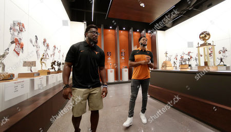 Brian Orakpo, Derrick Johnson. Former Texas football players Brian Orakpo, left, and Derrick Johnson, right, visits the Frank Denius Family University of Texas Athletics Hall of Fame, in Austin, Texas. Displays honor all 55 of Texas' National Championship teams, 599 conference team titles, hundreds of individual national champions, 171 Olympians at 21 Olympiads, academic All-Americans and other scholastic honorees, as well as the traditions and tales that encompass the history of Longhorns