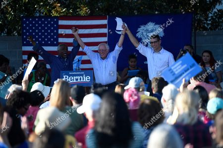 Stock Image of State Sen. Terry Alexander, left, and Florence Mayor Stephen Wukela, right, pose with Democratic presidential contender Bernie Sanders at a Medicare for All campaign event, in Florence, S.C