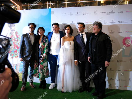 "Mexican director Mauricio Valle, from left, and actors Ileana Fox, Paco Rueda, Ximena Romo, Vadhir Derbez and Alejandro Camacho pose for photos as they arrive for a red carpet event for the film ""Como si fuera la primera vez,"" in Mexico City. ""Como si fuera la primera vez"" is a remake of ""50 First Dates"" and premieres on Friday, Aug. 30"