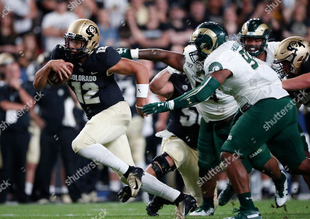 Steven montez, ellison hubbard, r m. Colorado quarterback Steven Montez, left, drives for a long gain past Colorado State defensive lineman Ellison Hubbard in the first quarter of an NCAA college football game, in Denver