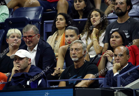 Brazilian model Adriana Lima (C) watches Novak Djokovic of Serbia verses Denis Kudla of the USA from Djokovic's family seating box during the fifth day of the US Open Tennis Championships at the USTA National Tennis Center in Flushing Meadows, New York, USA, 30 August 2019. The US Open runs from 26 August through to 08 September 2019.