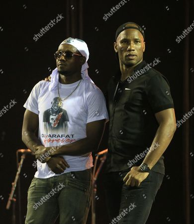Former soccer player Didier Drogba (R) attends a vigil by artists in tribute to the Ivorian musician DJ Arafat at Felix Houphouet Boigny stadium in Abidjan, Ivory Coast, 30 August 2019. Ivorian musician DJ Arafat, born Ange Didier Houon, died on 12 August 2019 of his injuries suffered in a 10 August motorcycle accident. President Ouattara and former soccer star Drogba were among the many offering condolences for the 33-year-old dubbed the 'King of Coupe-Decale'.
