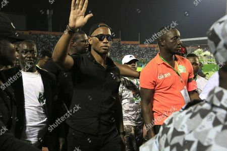 Former soccer player Didier Drogba (C) attends a vigil by artists in tribute to the Ivorian musician DJ Arafat at Felix Houphouet Boigny stadium in Abidjan, Ivory Coast, 30 August 2019. Ivorian musician DJ Arafat, born Ange Didier Houon, died on 12 August 2019 of his injuries suffered in a 10 August motorcycle accident. President Ouattara and former soccer star Drogba were among the many offering condolences for the 33-year-old dubbed the 'King of Coupe-Decale'.