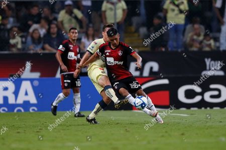 Christopher Trejo (R) of Atlas disputes the ball with Fernando Gonzalez (L) of America of America during day eight of the Mexican soccer tournament, held at Jalisco stadium Guadalajara, Mexico, 30 August 2019.