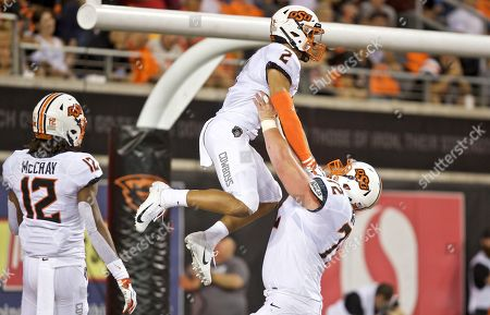 Tylan Wallace, Johnny Wilson. Oklahoma State Cowboys wide receiver Tylan Wallace and offensive lineman Johnny Wilson celebrate a touchdown during an NCAA football game on in Corvallis, Ore