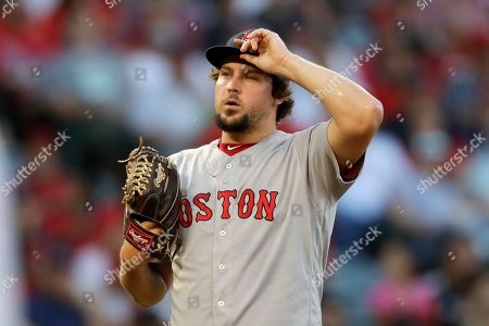 Boston Red Sox starting pitcher Josh Taylor reacts after loading the bases during the first inning of a baseball game against the Los Angeles Angels in Anaheim, Calif