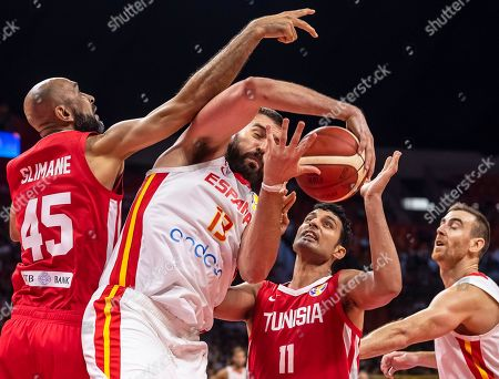 Stock Image of Marc Gasol (C) of Spain in action against Tunisian players Radhouane Slimane (L) and Mokhtar Ghyaza (2-R) during the FIBA Basketball World Cup 2019 group C match between Spain and Tunisia in Guangzhou, China, 31 August 2019.