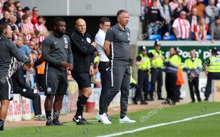 Peterborough United Manager Darren Ferguson on the touchline alongside Sunderland manager Jack Ross