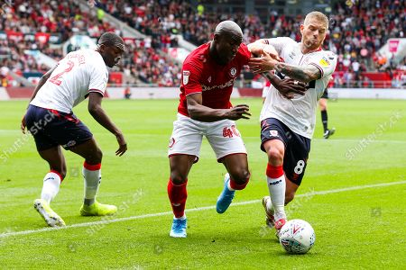 Benik Afobe of Bristol City is challenged by Adam Clayton of Middlesbrough