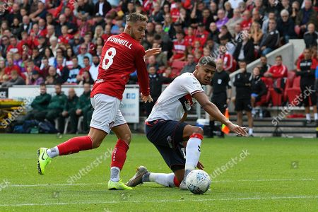 Ashley Fletcher (11) of Middlesbrough battles for possession with Josh Brownhill (8) of Bristol City during the EFL Sky Bet Championship match between Bristol City and Middlesbrough at Ashton Gate, Bristol