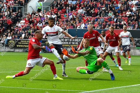Goal - Ashley Fletcher (11) of Middlesbrough shoots at goal with the save by Daniel Bentley (1) of Bristol City deflecting off Taylor Moore (23) of Bristol City for an own goal to make the score 1-1 during the EFL Sky Bet Championship match between Bristol City and Middlesbrough at Ashton Gate, Bristol