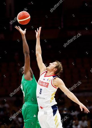 Al Farouq Aminu (L) of Nigeria in action against Vladimir Ivlev (R) of Russia during the FIBA Basketball World Cup 2019 match between Russia and Nigeria in Wuhan, China, 31 August 2019. The FIBA Basketball World Cup 2019 takes place from 31 August through 15 September 2019.