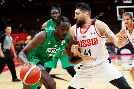 Stock Image of Al Farouq Aminu (L) of Nigeria in action against Nikita Kurbanov (R) of Russia during the FIBA Basketball World Cup 2019 match between Russia and Nigeria in Wuhan, China, 31 August 2019. The FIBA Basketball World Cup 2019 takes place from 31 August through 15 September 2019.