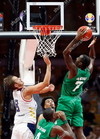 Al Farouq Aminu (R) of Nigeria in action against Vladimir Ivlev (L) of Russia during the FIBA Basketball World Cup 2019 match between Russia and Nigeria in Wuhan, China, 31 August 2019. The FIBA Basketball World Cup 2019 takes place from 31 August through 15 September 2019.