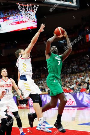 Stock Image of Al Farouq Aminu (R) of Nigeria in action during the FIBA Basketball World Cup 2019 match between Russia and Nigeria in Wuhan, China, 31 August 2019. The FIBA Basketball World Cup 2019 takes place from 31 August through 15 September 2019.