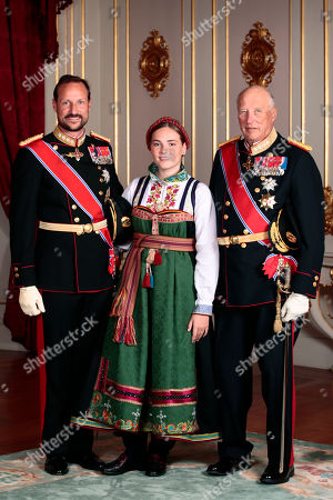 Norway's Princess Ingrid Alexandra (C) poses with her grandfather King Harald V (R) and father Crown Prince Haakon in the Royal Palace in Oslo, Norway, 31 August 2019. The 15-year-old daugther of of Crown Prince Haakon and Princess Mette-Marit was confirmed in the Palace Chapel after she has followed the confirmation teaching in the Asker congregation. Princess Ingrid Alexandra is second-in-line to the Norwegian throne after her father.
